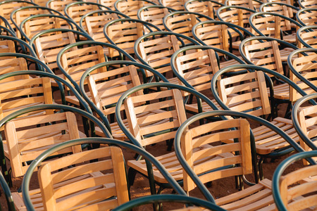 Wooden chairs. Empty stools without people. Concept photo - absence of audience. Stock Photo