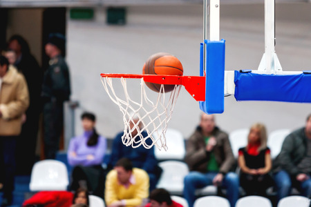 enters: Abstract sport background with basketball hoop. Sport equipment for team game. The ball enters the basket. Stock Photo