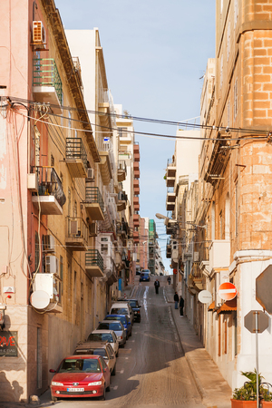passerby: SLIEMA, MALTA - February 13, 2010. One of narrow streets in Sliema, Malta. Editorial