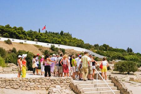 CARTHAGO, TUNISIA - August 29, 2007. Tourists near Carthago (Carthage), ruins of capital city of the ancient Carthaginian civilization. Editorial