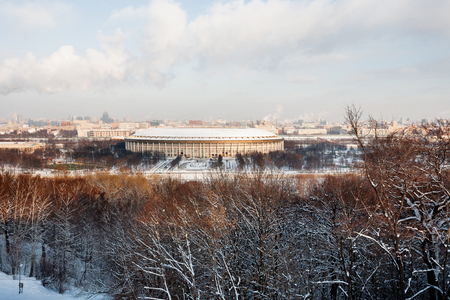 univercity: Panorama view on Luzhniki stadium and Sparrow Hills from observation deck near Moscow State Univercity (MSU). Winter sunny day. Moscow, Russia.