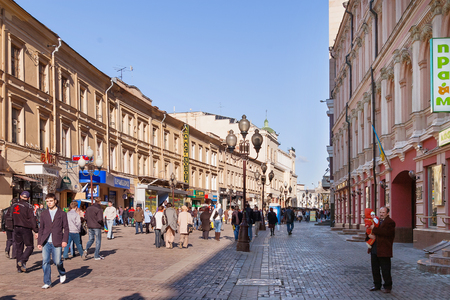 streetlife: MOSCOW, RUSSIA - March 25, 2007. People walking down the famous Arbat street in the historical center of Moscow. Old fashioned street with small souvenir shops and cafe for tourists.