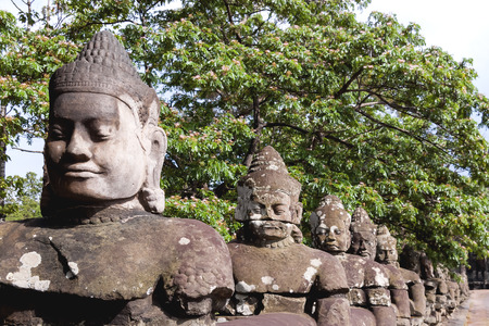 sacral: Stone sculptures near South Gate of Angkor Thom from outside the city. Angkor Wat. Siem Reap, Cambodia. UNESCO World Heritage Site.