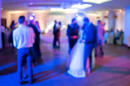 discoteque: Wedding. Dancing bride and groom, couples and guests. Blurred background. Stock Photo