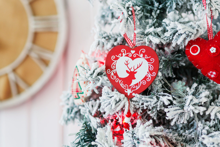 deer in heart: Christmas and New Year background with Eve Tree and decorations. Cozy holiday morning at home.