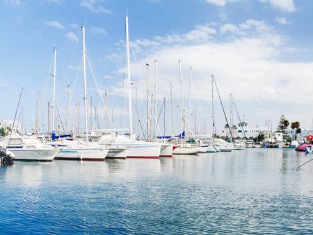 Sea port El Kantaoui, Tunisia. Many yachts moored to the pier. Stock Photo