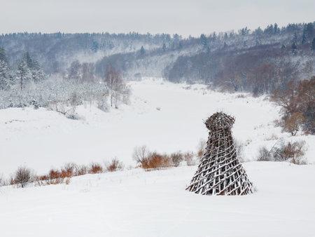 NIKOLA-LENIVETS, RUSSIA - January 15, 2017. Artobject Lighthouse on the Ugra, one of the most famous and longstanding land-art projects by Nikolay Polisski. An idiosyncratic symbol of Nikola-Lenivets.