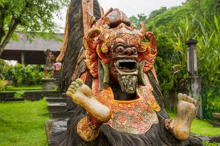 Water Palace of Tirta Gangga. Landmark in Bali, Karangasem, Indonesia. Statue of Barong. Winter rainy season.