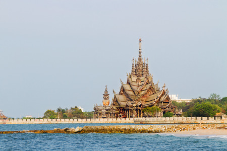 sacral: Sanctuary of Truth, all-wood building filled with sculptures based on traditional Buddhist and Hindu motives. Pattaya, Thailand. View from sea.