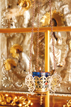 Candleholder, oil lamp. Details in the Orthodox Christian Church. Russia. Stock Photo