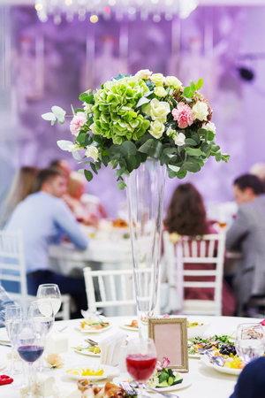 Table Set For Wedding Banquet With Floral Composition Of Roses