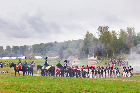 BORODINO, RUSSIA - September 06, 2015 - Reenactment of the battle of Borodino (the Patriotic war of 1812 year). Tourists watch the performance from from the fenced places. Moscow region, Russia.