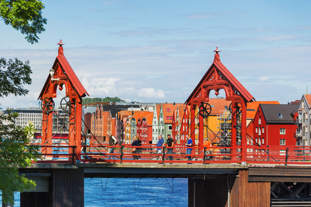 TRONDHEIM, NORWAY - July 15, 2017. Tourists walking on Gamle Bybro - The Old Town Bridge, also known as Lykkens Portal (Portal of Happiness).