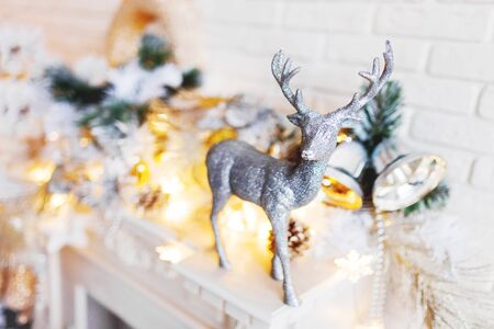 Christmas and New Year decorations with silver deer. Holiday winter background.