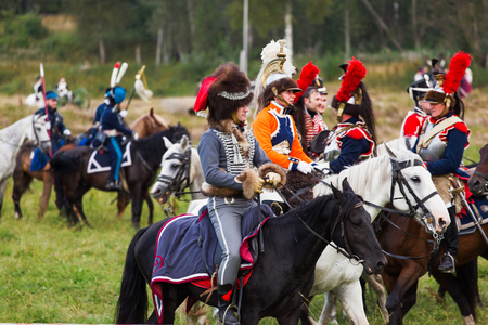 BORODINO, RUSSIA - September 02, 2017 - Reenactment of the battle of Borodino (the Patriotic war of 1812 year). Tourists watch the performance from from the fenced places. Moscow region, Russia. Editorial