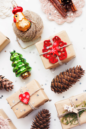 pinecones: Christmas and New Year background with handmade presents wrapped in craft paper and decorations, holiday symbols. Place for text.