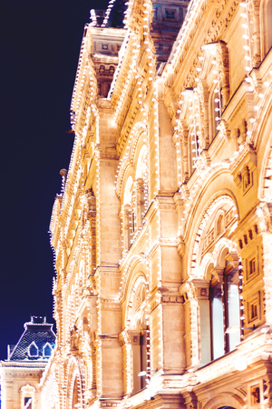 Streets of Moscow decorated for New Year and Christmas celebration. Main Department Store walls decorated with light bulbs. Russia.