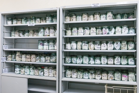 MOSCOW, RUSSIA - June 24, 2009. Glass jars with rags inside - samples of humans sweat and blood. Shelves with material evidences in laboratory of examination human olfactory traces.