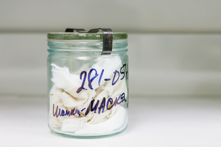 MOSCOW, RUSSIA - June 24, 2009. Glass jar with rags inside - sample of deadbodys blood. Shelves with material evidences in laboratory of examination human olfactory traces. Editorial