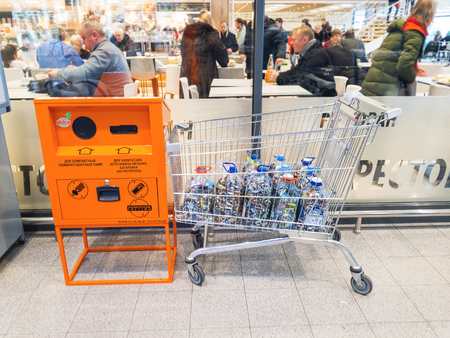 ODINTSOVO, RUSSIA - December 09, 2017. Separate waste collection - people bring batteries for recycling. Globus supermarket.