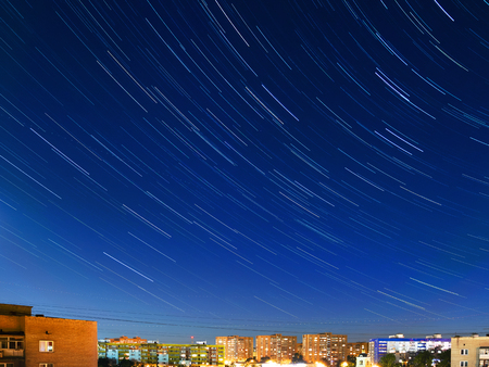 Star tracks over Odintsovo town, Moscow region, Russia. Long exposure of starry night sky.