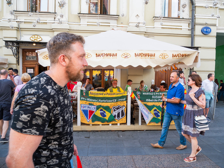 MOSCOW, RUSSIA - July 01, 2018. Tourists and local football fans walking on Nikolskaya street before game Russia-Spain (FIFA World Cup 2018).