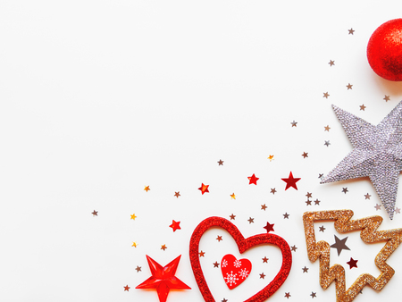 Christmas and New Year background with decorations - shiny stars, balls, snowflakes, heart, confetti. Place for text.
