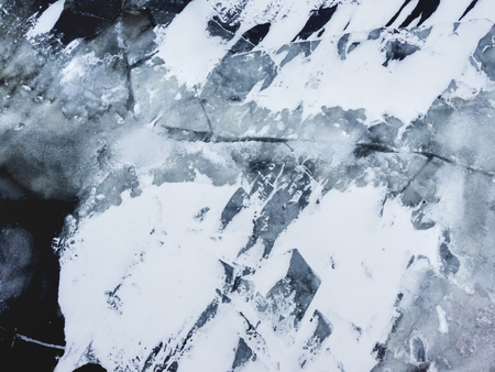 Broken ice on a frozen river.