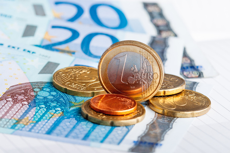 Euro coins and banknotes. European money, official currency of 19 of 28 member states of the European Union.