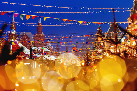 MOSCOW, RUSSIA - December 16, 2017. Red Square decorated for New Year and Christmas fair. Crowd of people near GUM (Main Department Store) building with light bulbs. Editorial