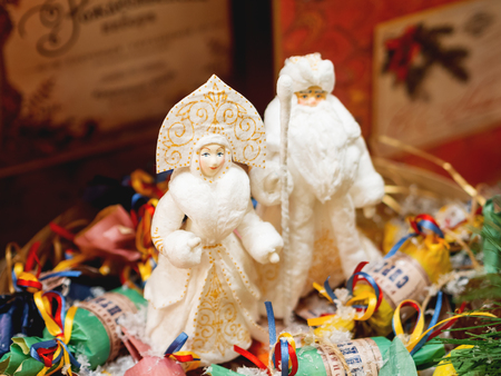 MOSCOW, RUSSIA - December 02, 2018. Vintage traditional New Year decoration - Grandfather Frost with his granddaughter, made of cotton, decorative toys for Christmas tree.
