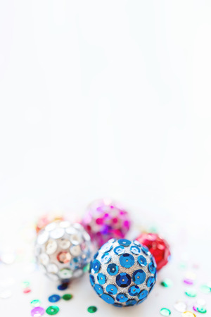 Christmas and New Year background with bright balls. Hand made decorations for Christmas tree with colorful sparkling spangles. Place for text. 免版税图像