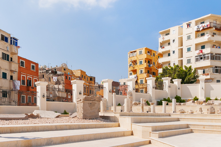Houses outside the fence of the Serapeum of Alexandria. Ancient architectural landmark in Egypt.