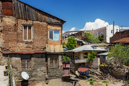 Tbilisi, old part of town with cobbled pavement and antique buildings. Old fashioned houses in historical quarter. Georgia.