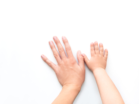 Hands of adult and child. Mother and kid put their palms together on white background. Parent and toddler. Symbol of family, unanimity, support.