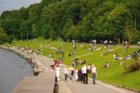 MOSCOW, RUSSIA - June 14, 2008. People are resting in Sparrow Hills park. Moscow-river embankment with relaxing local people and tourists.