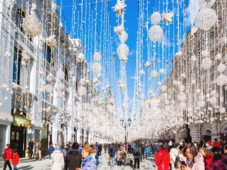 MOSCOW, RUSSIA - March 09, 2019. Nikolskaya street decorated with light bulbs.