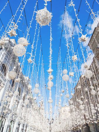 MOSCOW, RUSSIA - March 09, 2019. Famous Nikolskaya street decorated with light bulbs. Wall of Main Department Store (GUM).