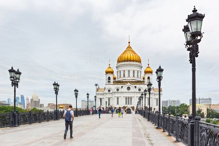 MOSCOW, RUSSIA - August 04, 2017. View of Cathedral of Christ the Savior. People walking on Patriarshiy bridge. Redakční