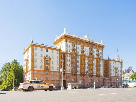 MOSCOW, RUSSIA - May 18, 2019. Uber taxi car is moving pass building of Embassy of the United States of America. Redakční
