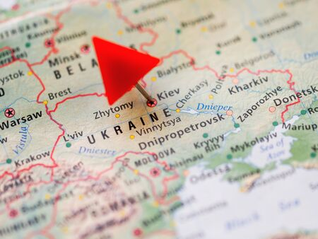 World map with focus on Ukraine with capital city Kiev. Red triangle pin points on it.