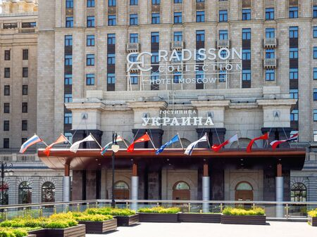 MOSCOW, RUSSIA - May 18, 2019. Main entrance of Hotel Ukraine, Radisson Collection. Historical building on Kutuzovsky Prospekt in sunny spring day.