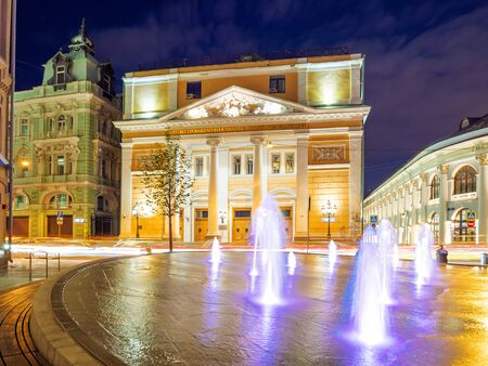 MOSCOW, RUSSIA - June 03, 2018. Illuminated fountain on square in front of Chamber of Commerce and Industry of the Russian Federation and Old Merchant Court. Night panorama view.