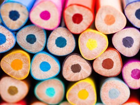 Ends of colorful  pencils. School supplies background. Kids stationery. Back to school macro backdrop.