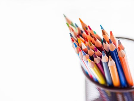Bunch of colorful watercolor pencils on white background. School supplies. Kids stationery with copy space. Back to school backdrop.