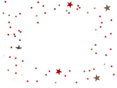 Frame made of scattering stars confetti on white background. Holiday backdrop.