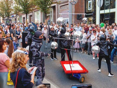 MOSCOW, RUSSIA - September 07, 2019. Procession of street theater actors and musicians in costumes of robots down Tverskaya street. Street festival and different leisure activities on Moscow Day celebration.