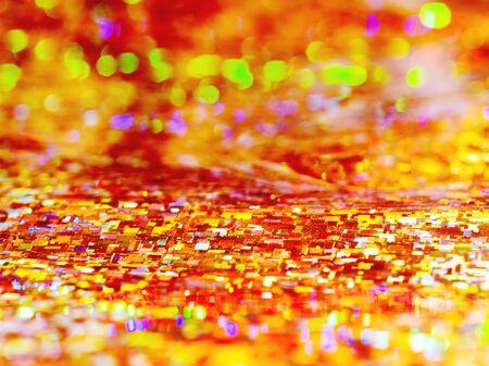 Bright orange background. Shiny and sparkling holographic rainbow backdrop.