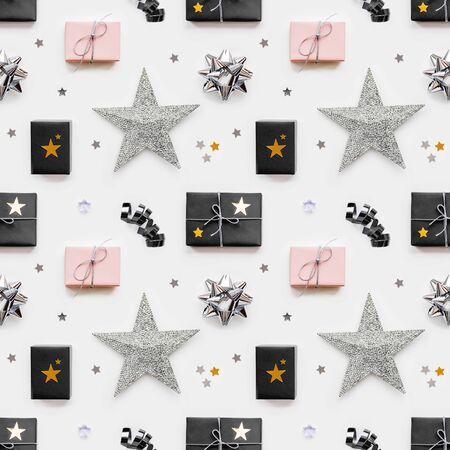Photo seamless pattern with holiday presents. Gifts wrapped in pale pink and black paper with silver ribbons and bow. Stars confetti. Top view, flat lay.