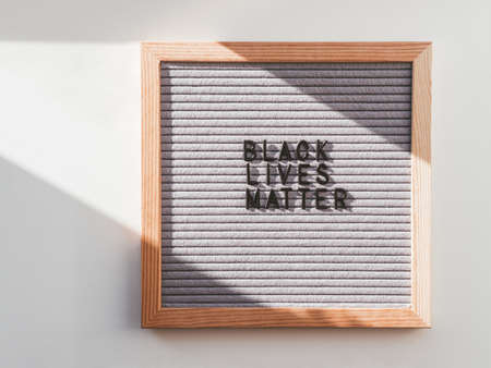 Top view on letterboard with words Black Lives Matter. Flat lay concept with actual statement. Social issue. Race problem in society.